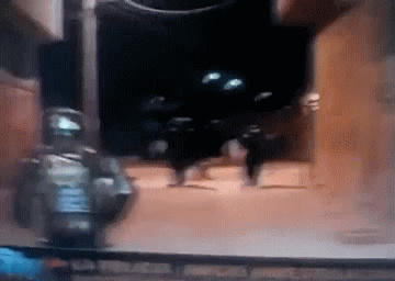 starting trouble with riot gear cop = bad idea